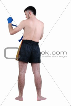 boxer in shorts . Rear view. Isolated over white.