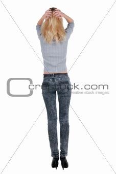 Beautiful young woman looking at wall.
