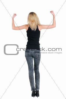 Blonde shows a biceps. Rear view.