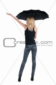 Blond young woman under an umbrella. Isolated over white.
