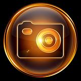 Camera icon golden, isolated on black background.
