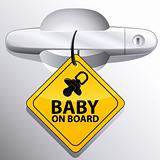 car door handle and baby on board sign