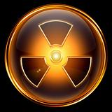 Radioactive icon golden, isolated on black background.