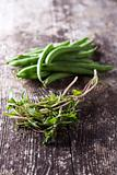 french beans and summer savory on wood