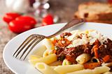penne bolognese and parmigiano cheese