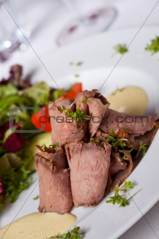 slices of roast beef with salad