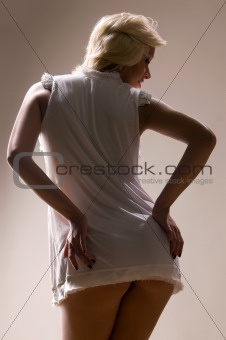 blonde woman in a white shirt