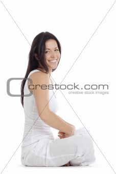 portrait of a woman sitting on the floor smiling - isolated on white