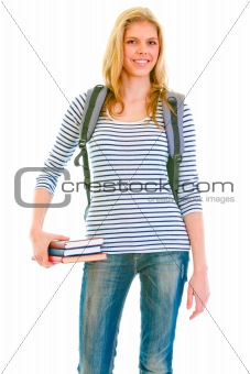 Cheerful teen girl with schoolbag holding books in hand