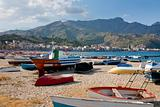 boats on  beach Giardini Naxos in summer day, Sicily