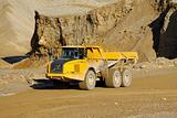 Yellow dump truck in mine