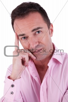 Portrait of a handsome middle-age man thinking, on white background. Studio shot