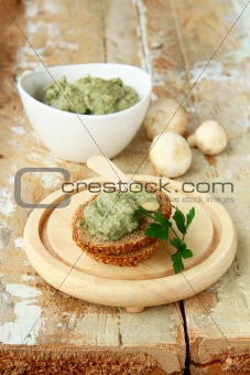pate of mushrooms on a wooden table organic product