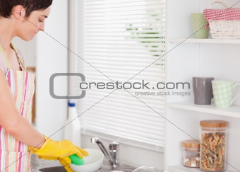Beautiful woman washing the dishes