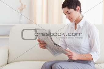 Beautiful woman reading the news