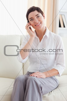 Close up of a joyful woman with a cellphone