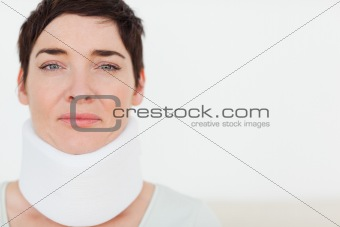 Close up of a sad Woman with a surgical collar