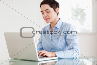 Charming short-haired businesswoman with a laptop