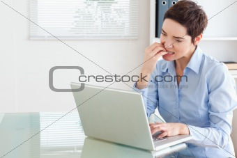 Angry brunette Businesswoman with a laptop