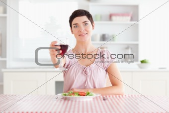 Cute Woman toasting with wine
