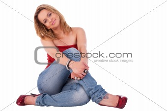 beautiful and elegant middle-age woman, seated on floor, isolated on white, studio shot