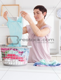 Cute Woman folding clothes