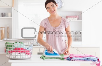 Cute Woman ironing clothes