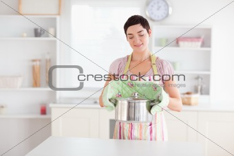 Cute Woman holding a pot