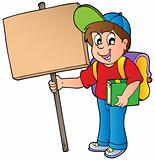 School boy holding wooden board