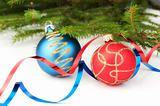 Christmas baubles with curly ribbon and christmas tree