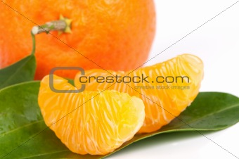 Ripe tangerines with leaves and slices