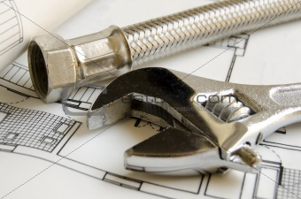 Plumbing tools on house blueprint