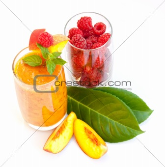 Peach cocktail with mint leaves and raspberries