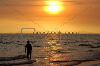 Man in sea on sun set