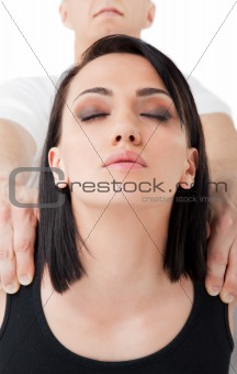 Female face shoulders massaged