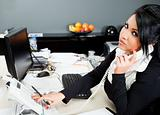 hispanic female on phone in office