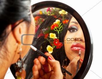 beautiful woman applying lipstick