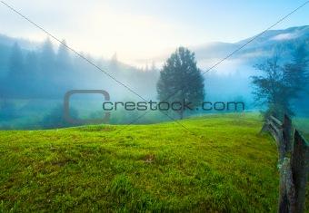 Hazy daybreak in mountain valley