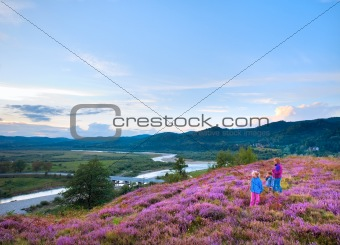 Summer heather flower hill and family on hill top