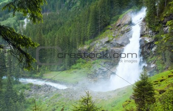 Alps waterfall summer view