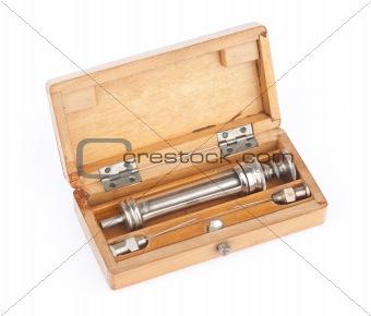Old syringe in a case