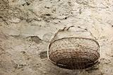 wicker basket by the stone wal