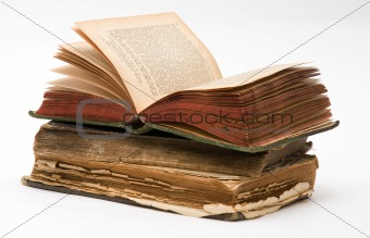 Stack of Old frayed books isolated over white background