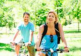 Young happy couple riding a bicycle