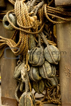 Old rope and wooden block pulleys