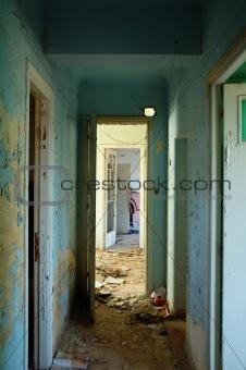 peeling hallway in abandoned building