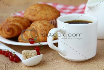 breakfast with fresh coffee, fresh croissants and fruits