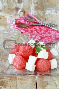 Watermelon salad with feta cheese and greens