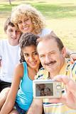 Happy family taking self portrait