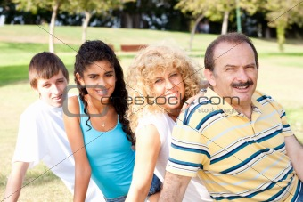 Portrait of family relaxing in park